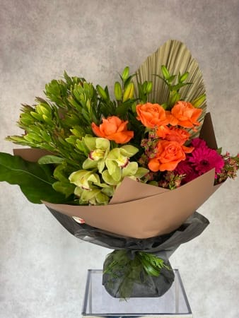 Stunning bright bouquet of Lilies, orchids, gerberas with boronia and leucadendron